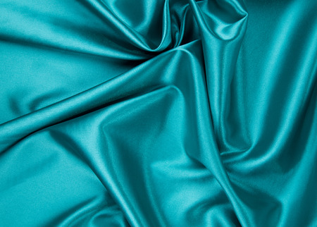 blue silk: Soft folds of deep blue silk cloth texture. Whole background.