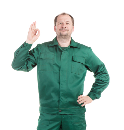 uniform green shoe: Worker in green with great sign. Isolated on a white background. Stock Photo