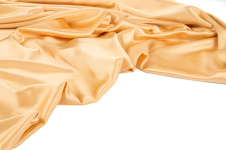 tela seda: Close up of golden silk cloth texture. Whole background.