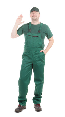 uniform green shoe: Worker in green overalls with great sign. Isolated on a white background. Stock Photo