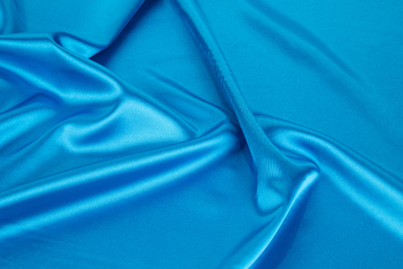 sexual abstract: Soft folds of deep blue silk texture. Whole background.