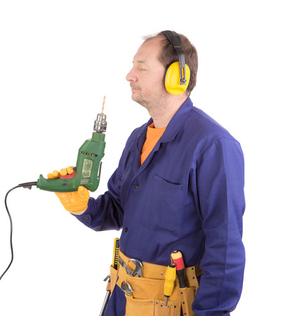 ear muffs: Worker in hard hat holding drill. Isolated on a white background.