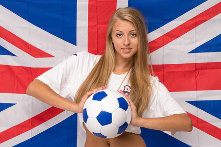 gaiters: Female model on flag. Soccer located close up.