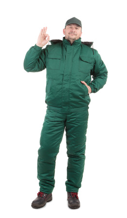 uniform green shoe: Worker with arm. Isolated on a white background.