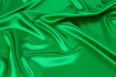 drapery: Green silk drapery. Isolated as a whole background.