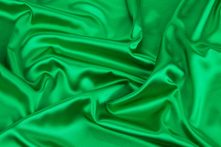 drapery: Green drapery. Isolated as a whole background. Stock Photo
