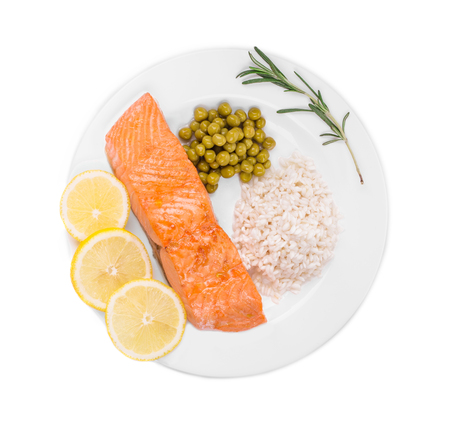 lemon slices: Fried salmon fillet on plate with lemon and rice