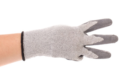 tumb: Hand in gloves shows three. Isolated on a white background.