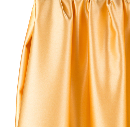 sensuous: Golden silk drapery. Isolated as a whole background.