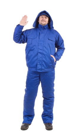 workwear: Worker in blue workwear. Isolated on a white background. Stock Photo