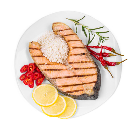 fish plate: Fried salmon fillet on plate with lemon and rice