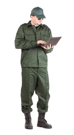 uniform green shoe: Man in workwear stands with notebook. Isolated on a white background. Stock Photo