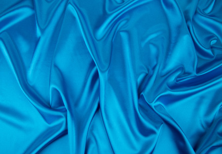 satiny: Blue silk drapery. Isolated as a whole background.