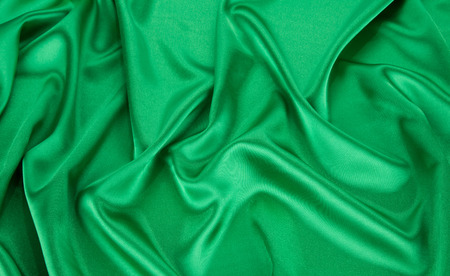 satiny: Green silk drapery. Isolated as a whole background.