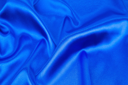 cloth texture: Soft folds of deep blue cloth texture. Whole background.