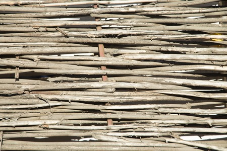 straw twig: woven willow wicker fence panel suitable for crafts Stock Photo