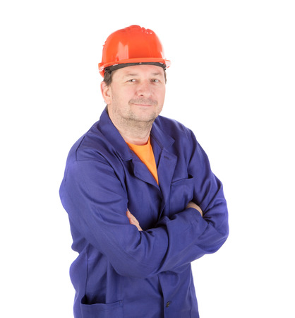Man in working clothes with crossed arms. Isolated on a white background.