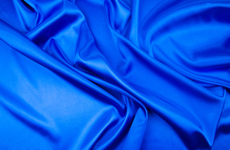 blue silk: Blue silk cloth texture close up. Whole background. Stock Photo