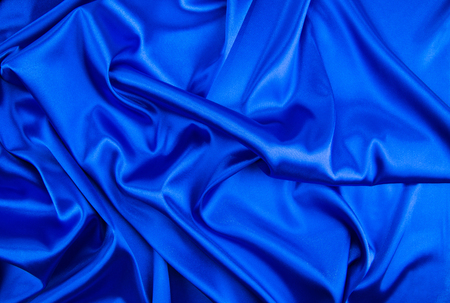 deep blue: Soft folds of deep blue silk texture. Whole background.