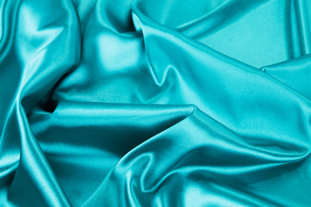 blue silk: Light blue silk texture. Close up on th whole background.
