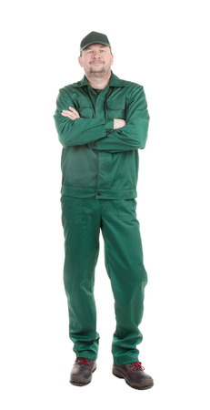 uniform green shoe: Worker with crossed arms. Isolated on a white background.