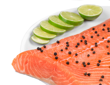 ready to cook food: Salmon fillet with pepper lime. Whole background. Stock Photo