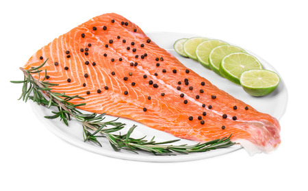 ready to cook food: Salmon fillet with pepper lime and rosemary. Isolated on a white background.