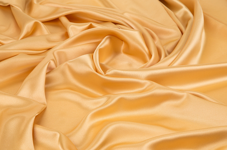 drapery: Golden silk drapery. Isolated as a whole background.
