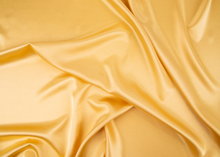 cloth texture: Closeup of yellow silk cloth texture. Whole background.