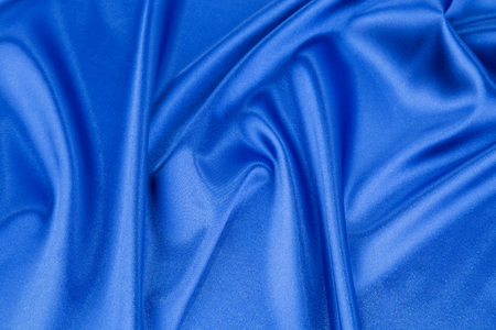 deep blue: Soft folds of deep blue silk cloth texture