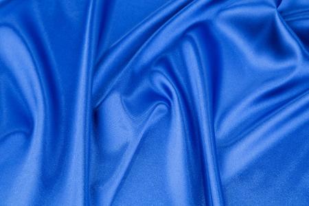 blue silk: Soft folds of deep blue silk cloth texture