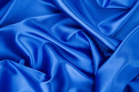 blue silk: Blue silk folds texture close up