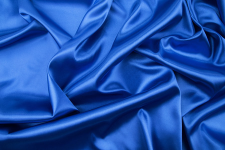 blue silk: Soft folds of blue silk cloth. Whole background. Stock Photo