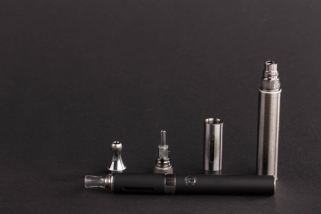 inhalator: Big advanced electronic cigarette. Located on a black background. Stock Photo