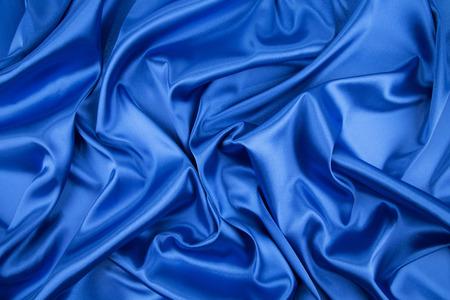 blue silk: Blue silk cloth texture closeup. Whole background.