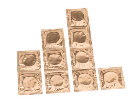 condoms: Set of condoms in golden packing isolated on white background Stock Photo