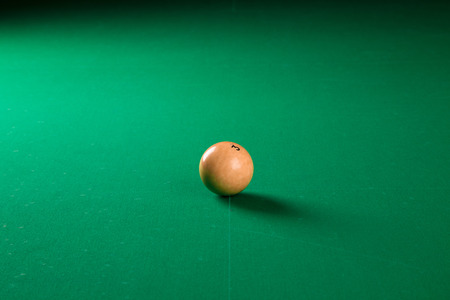 snooker halls: Billiard ball in a pool table in the closeup Stock Photo