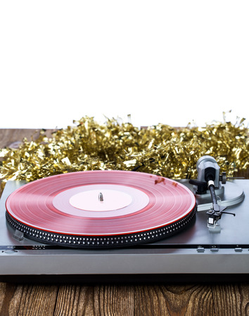 Analog music player with christmas decoration on a wooden table Stock Photo