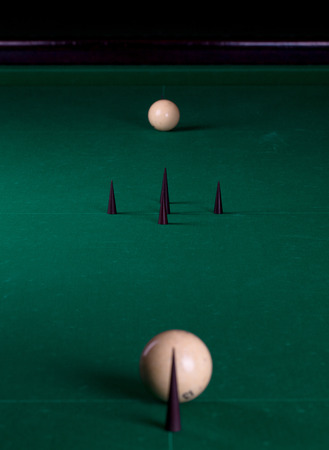 snooker hall: Billiard balls in a pool table in the closeup