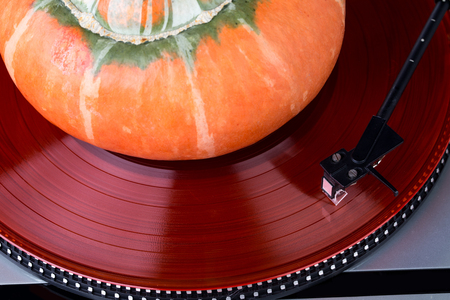 78 rpm: Analog music player with pumpkin as a whole background Stock Photo