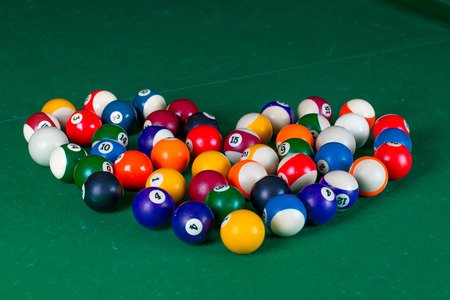 snooker hall: Billiard balls in shape of heart in a green pool table Stock Photo
