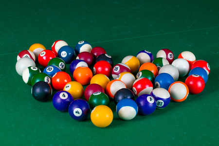 snooker halls: Billiard balls in shape of heart in a green pool table Stock Photo