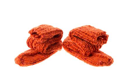 children s feet: orange socks isolated on white background in the closeup
