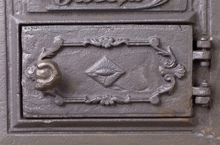 firebox: Cast iron door for furnaces. Close up of fragment.