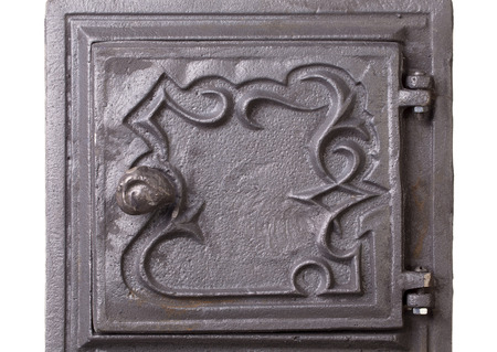 firebox: Cast iron door for furnaces. Fragment. Located on the white background.