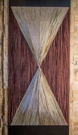 wall sconce: Sconces like hourglass. Located on a beige masonry.