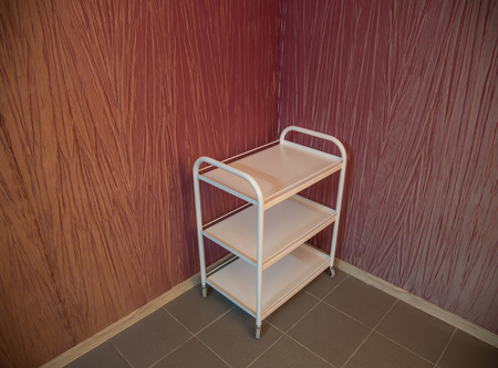 emergency cart: Medical devices utility cart standing in the corner Stock Photo
