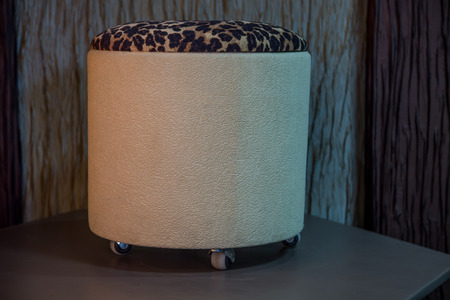 pouffe: Contemporary beige leather pouffe with animal print Stock Photo