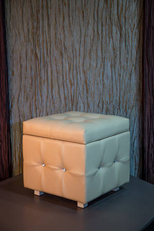 diamante: Beige leather cube chair with diamante buttons