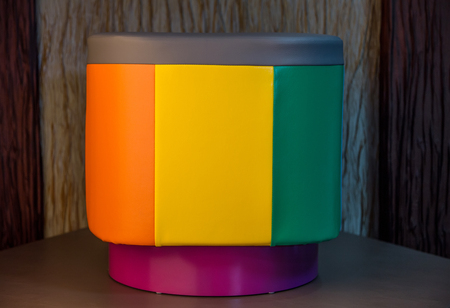 pouffe: Contemporary leather round pouffe with multicoloured stripes
